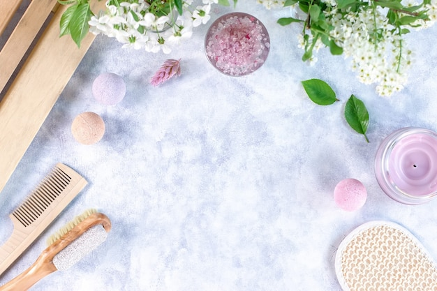 Natural body care products and accessories lay out with flowers and leaves. eco friendly spa, beauty cosmetics concept with copy space.