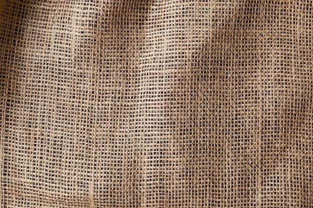 Стена из натуральной коричневой льняной ткани