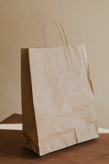 Natural brown paper bag on wooden table