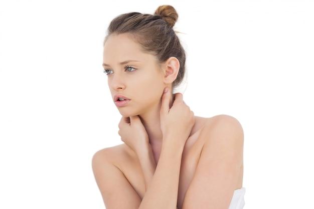 Natural brunette model posing looking away