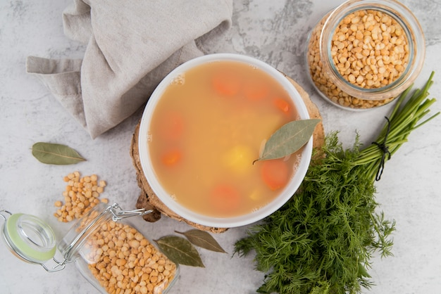 Natural chickpeas soup in bowl with bay leaf