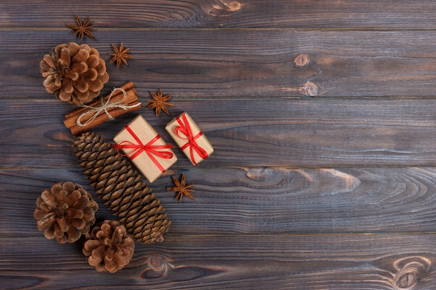 Natural christmas accessories pine cones wooden star decorated linen cord cinnamon vintage gifts on wooden background