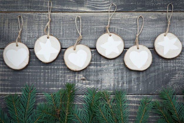 Natural christmas decoration hanging on wooden wall