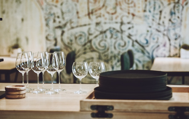 Natural clay brown plates and glass goblets in a cafe