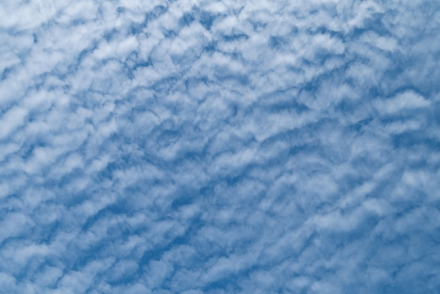 Natural clear blue sky with some clouds for background or backdrop freedom concept