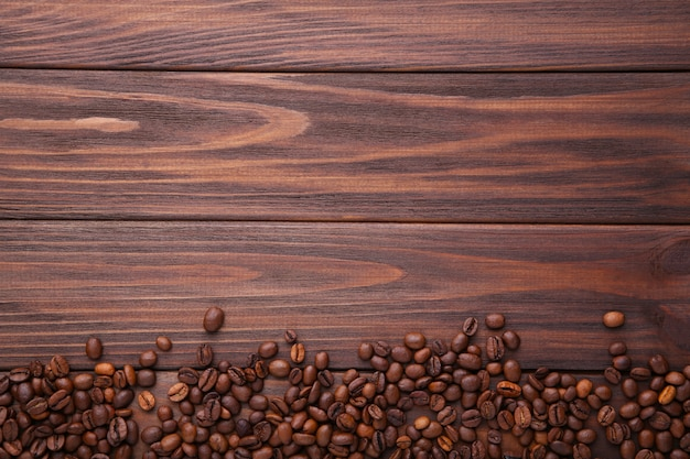 Natural coffee beans on brown wooden