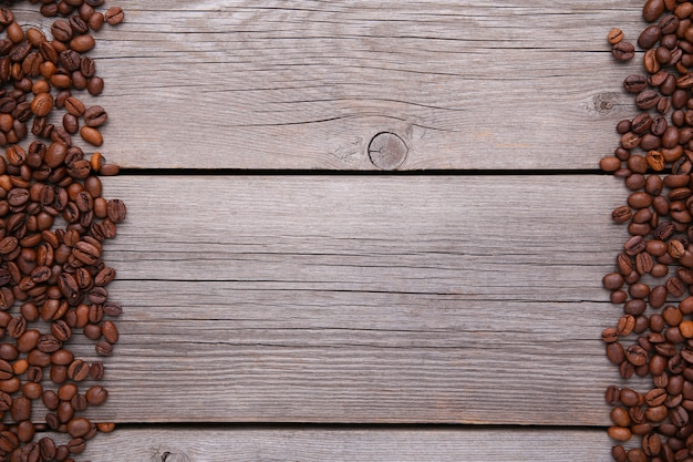 Natural coffee beans on grey wooden