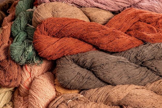 Natural color dyed cotton yarn for weaving in local thailand, natural raw material of weaving fabric for modern cloth