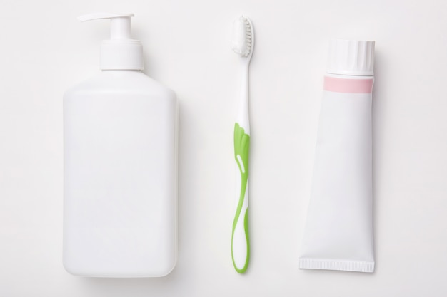 Natural cosmetic products isolated over white wall toothpaste, toothbrush and bottle of cream. beauty concept. hygiene