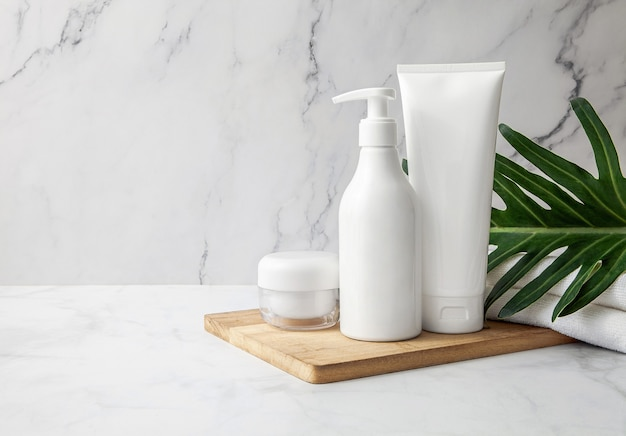 Natural cosmetic products set with green leaf on marble background. copy space