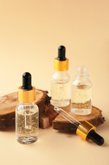Natural cosmetic skincare bottle container with wood on beige surface