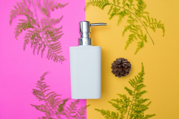 Natural cosmetics bottle containers on color paper background