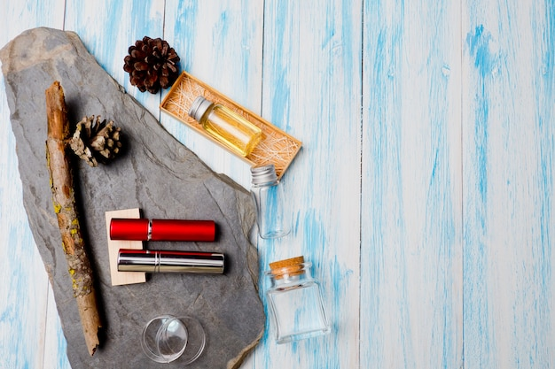 Natural cosmetics bottle containers on wood background