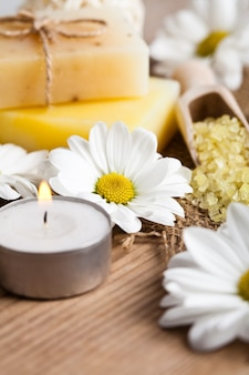Natural cosmetics concept: soap with daisies