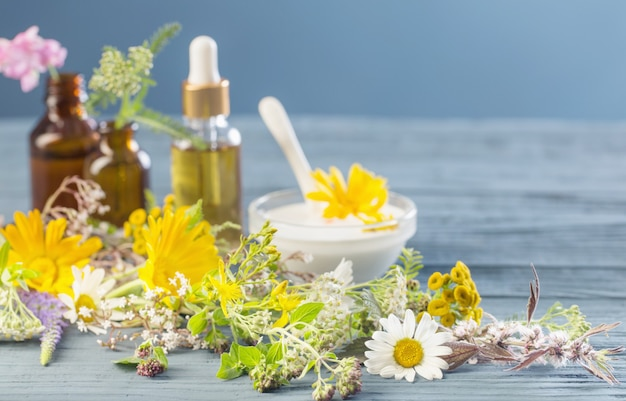 Natural cosmetics from herbal ingredients on  blue background