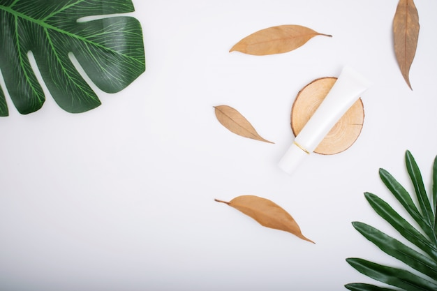 Natural cosmetics with leaves on a white