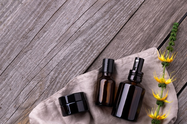 Natural cosmetics in zero waste eco friendly containers on wooden background