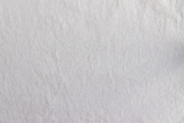 천연 코튼 저지 패브릭 질감. 구겨진 된 베이지 색 직물 배경