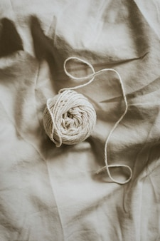 Natural cotton yarn on gray textile