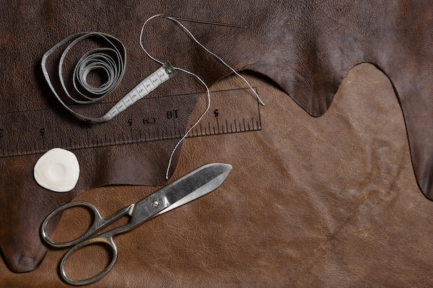 Natural cow leather with crafting tools