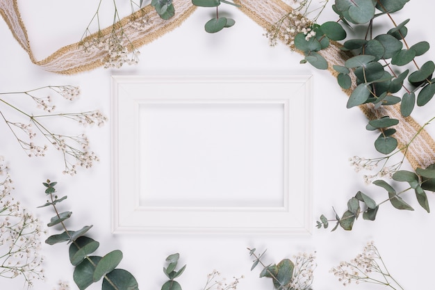 Natural decoration with ribbon and a frame