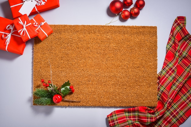 Natural doormat flat lay,  with christmas decorations