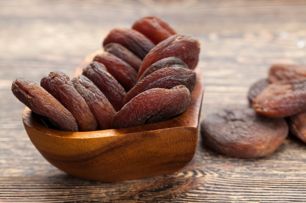 Natural dried apricots in the sunlight, natural dark-colored sweets made from apricot fruit