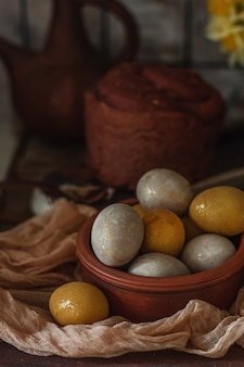 Natural dye for easter eggs - turmeric and beetroot on vintage wooden background