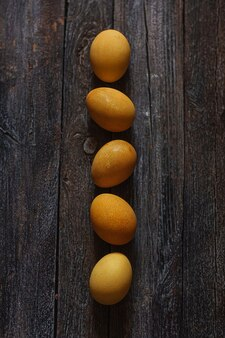 Natural dye for easter eggs - turmeric on vintage wooden background