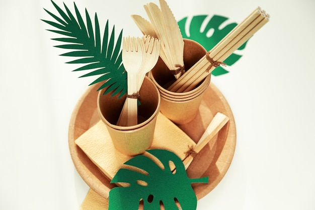 Natural eco-friendly bamboo and paper tableware. the concept of recycling, nature conservation and saving the earth. selective focus.