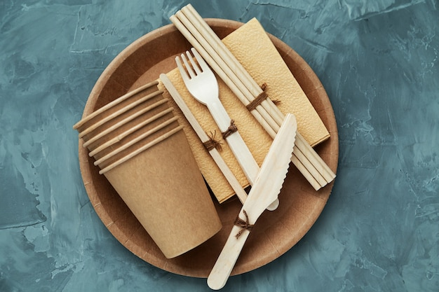 Natural environmentally friendly bamboo and paper tableware. the concept of recycling, nature conservation and saving the earth.
