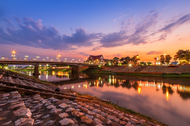 Natural evening at view the nan river and the naresuan bridge in the park