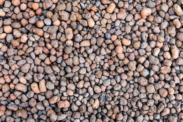 Натуральный керамзит - легкий и пористый строительный материал. фактура и рисунок камня.