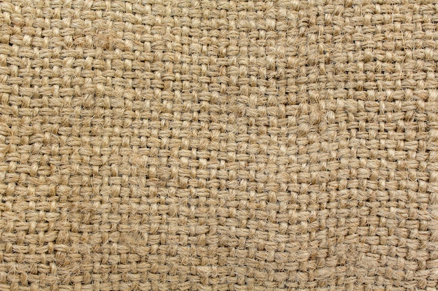 Natural fabric burlap, brown background