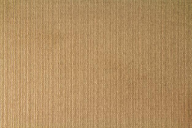 Натуральная ткань льняная текстура для дизайна, вретище текстурированная. коричневый холст фон. хлопок.