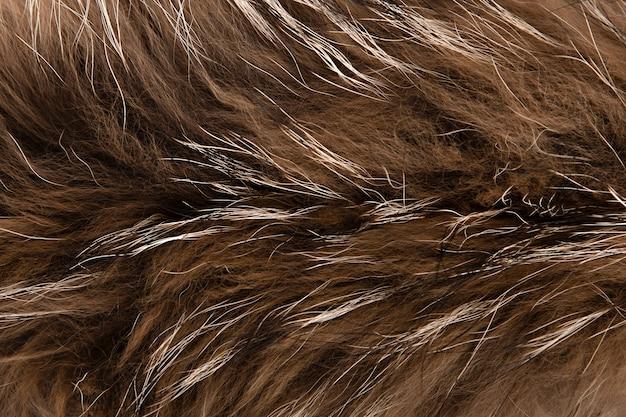 自然な毛皮の茶色の背景をクローズアップ