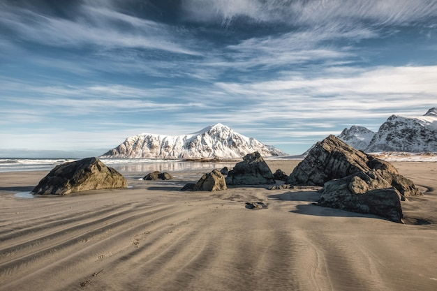 Natural furrow sand with snow mountain and blue sky at skagsanden beach