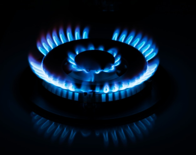 Natural gas burning on kitchen gas stove in the dark
