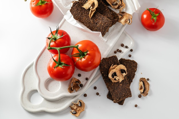 Natural gluten-free bread without flour and sugar with mushrooms and tomatoes, top view