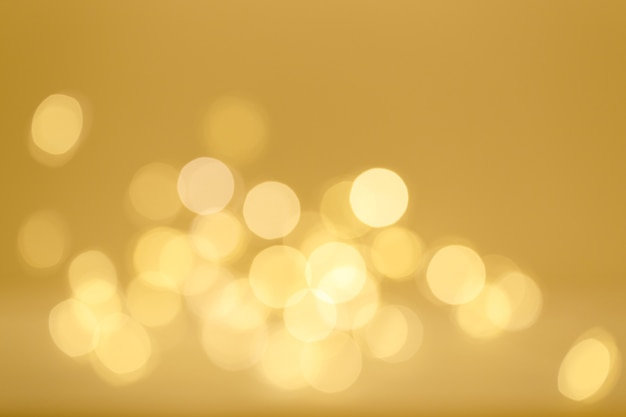 Natural gold bokeh lights, christmas or new year blurred background