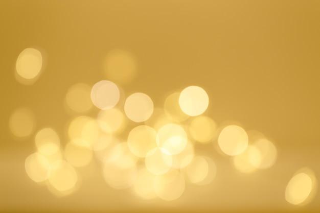ナチュラルゴールドのボケライト、クリスマスや新年のぼやけた背景