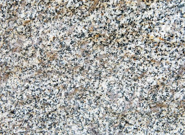 自然な花崗岩の石のテクスチャと表面の背景