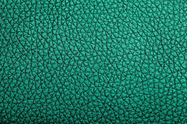 ナチュラルグリーンの革の背景。マクロ撮影