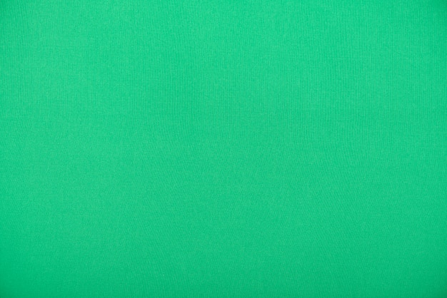 Natural green textile, smooth fabric as texture or background Premium Photo