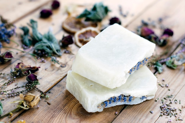 Natural handmade lavender soap on a wooden background with dried flowers