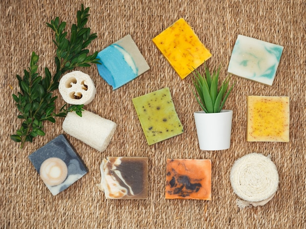 Natural handmade skincare. organic soap bars with plants extracts. stacks homemade bars of soap with herbal material. natural soap with spa accessories.