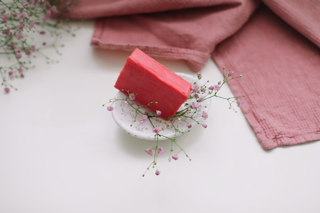 Natural handmade soap bar with ceramic soap dish and flowers spa organic soap sustainable lifestyle