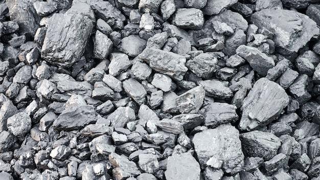 Текстура природного каменного угля для фона. угольная промышленность