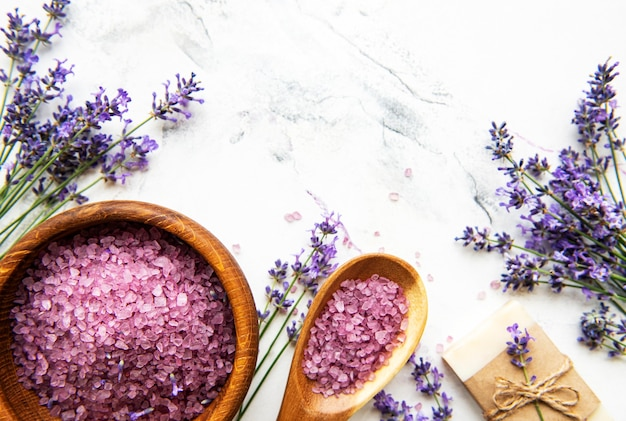 Natural herb cosmetic with lavender,  flatlay on white marble background,  top view