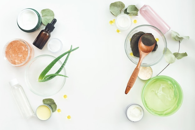 Natural herbal skin care products, top view ingredients on table concept of the best all natural face moisturizer. facial treatment preparation background